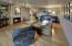 Masonry Fireplace, wood floors track lighting