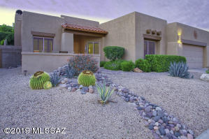 Professionally landscaped front with desert plants adds curb appeal
