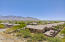 Enjoy only having one side yard neighbor at this corner lot location which also provides views.