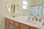 Double sinks in the hall bath reduces wait time in the mornings.