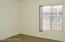 Another spacious and separated bedroom.