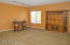 This front room is very large and can be used for many different purposes, including as a formal living/dining room.