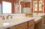 Smooth integral cultured marble counters are used in the master bathroom.