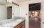 Dual vanities and convenient access to Arizona room.