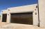 Metal doors on side entry 3 car garage with 2' extension.