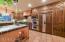Sub Zero refrigerator with matching cabinet wood inlay