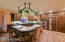 Mesquite & Alder custom made wood cabinetry with Travertine tile counters