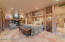 Stone floors, custom built in cabinetry and entertainment system with surround sound