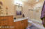 """Newly remodeled with 3/8"""" clear glass shower doors, cabinets, granite,& fixtures"""