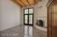 Master bedroom with scored concrete floors