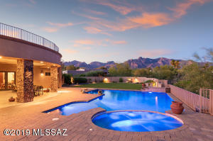 Stunning Mountain Views at this show-stopping Shadow Hills 2008 Home. Dream Backyard with Pool, Spa, Large Turf Area, Outdoor Kitchen/Fireplace, Roof-top Deck and More!