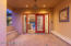 Double door entrance with artistic tile murals and stunning glass work.