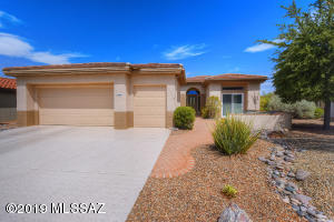 WELCOME TO 14267 N BUCKINGHAM DRIVE - REMODELED HOME WITH 2 + GOLF CART CAR GARAGE!