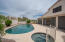 Pebble-Tec pool and spa are gas-heated and self-cleaning with jets.