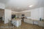 Freshly painted, here is another view of the expansive kitchen and desk, perfect for the gourmet chef in you!