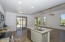 Family room off kitchen is ideal for sharing time with guests, friends and family while everyone helps in the kitchen!