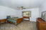Huge master bedroom downstairs with en-suite bath and walk-in closet.