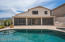 Check out the end-to-end covered patio that is screened in.