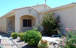 Lush desert landscaping and a custom brick walkway to the door of your new home.