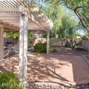 Tranquil backyard oasis sip your coffee, enjoy the hot tub, plant some potted plants and feed the hummingbirds from this retreat.