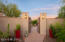 Enter courtyard through historical wood doors from old Mexico