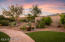 Numerous patios for entertaining - this one in the front courtyard