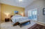 Spacious master suite with vaulted ceiling and private balcony with mountain views!
