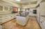 Freshly painted cabinets & new backsplash