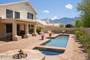 Enjoy great Pusch Ridge views from the finished backyard w/heated pool.