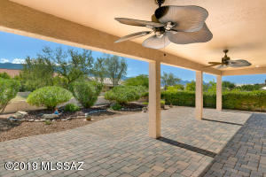 Patio is south-east facing with mountain views, pavers & ceiling fan.