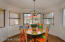 Wonderful dining area in kitchen with sliding doors leading to front outdoor patio.