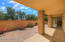 Privacy and easy care with this enclosed back patio area. Side access with a gate to the east of the patio.