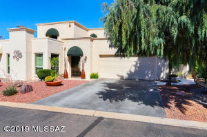Welcome to 8011 N Casas Placita located in gated adult golf community at Omni Tucson National