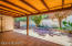 12-foot deep patio with storage. Stone Sitting Wall for trees and flowerbeds. Bricked outer area: Porcelain Tile under covered roof.