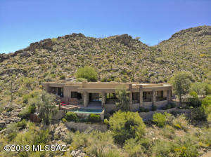 Set up into the hillside this home is truly a marvel with it's hillside backdrop, excellent privacy & perched views.