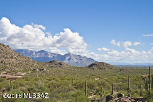 Standing at the edge of the fence in the yard provides you this spectacular view of the nearby Tortolita Mountains and the more distant Catalina Mountains and Pusch Ridge.