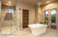 Free-standing tub leading to private Zen Garden