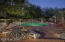 The custom designed pool and spa are nestled in a beautifully landscaped setting with an abundance of mature trees.