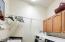 Laundry w/upper cabinets under Washer-Dryer