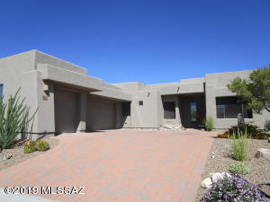 Semi-Custom 4 bedroom beauty in Sky Ranch Estates with a paver driveway to the 3 car garage..