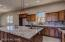 Kitchen with Granite Countertops, Custom Cabinets, Backsplash
