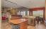 Large updated kitchen with granite counter tops and custom features.