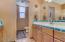Guest bathroom with dual vanities.