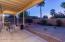 Patio and yard at dusk.