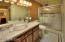 Ensuite master bath with walk in shower, crushed stone counter and bowel sink