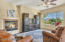 The Family room sets as the gathering place right next to and an extension of the kitchen. The center island divides the two spaces. Massive windows and 10 ft ceilings enhance the feeling of spaciousness and allow the Mountain to appear to be right in your entertaining space