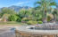 The mountain views from all areas both inside and out are amazing. The raised Spa with waterfall cascades into the pebbletec pool with in ground cleaning system. Pool is nestled in a private stop in the large rear yard where the stunning mountain views can be enjoyed. Palm trees and other lush growth give the feel of Serenity and peace. There is no traffic noise here which makes it doubly inviting and peaceful
