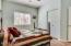 Guest bedroom has a semi-walk-in closet and ceiling fan w/lights