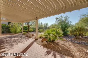 Welcome Home. Backyard Oasis borders desert common area and is highlighted with an expanded patio.