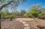 Backyard with additional paver patio area.